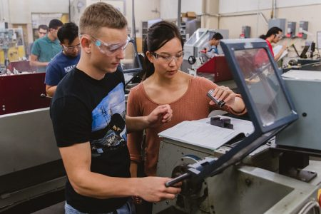 Two students working at the engineering student design center