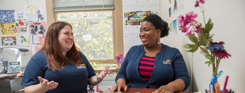 Ashley Jess, a Forensics Graduate Student chats with career advisor Marjannie Akintunde, in her office in South Hall