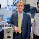 Lifeng Lai, Eric Kurzrock and Soheil Ghiasi, pictured in the Department of Urologic Surgery at UC Davis Health, are developing a wearable biosensor that can monitor bladder fullness for people with spinal cord injuries. (Wayne Tilcock/UC Davis Health)