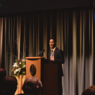 Shelten Yuen speaking at the 2019 Alumni Celebration event.